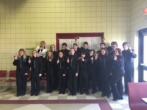 Band Booster. Gorup of Students dressed in Black Robes in Band Room